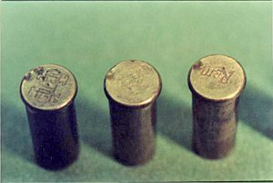 Photograph of the left 3 cases.  The double firing pin strike supports Mr. Waller's, and witnesses, testimony that a warning shot was fired and, after a pause, the revolver was fired until ammunition expended.